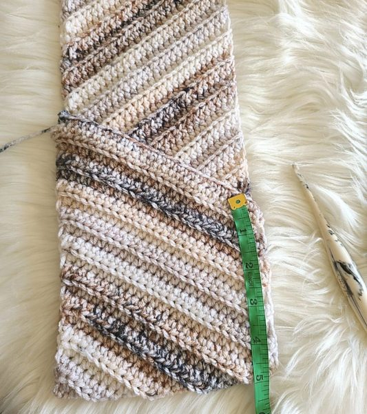 How to create the pocket for this scarf, shown with ruler for sizing.