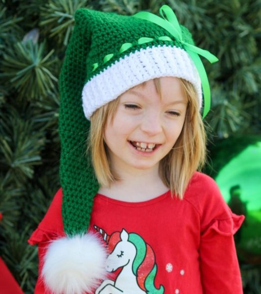 Child's crochet stocking cap on a little girl.