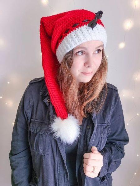 Adult crochet stocking cap on woman.
