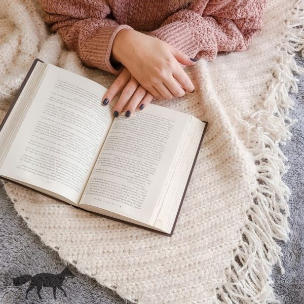 Bulky Crochet Throw blanket, shown with person reading.