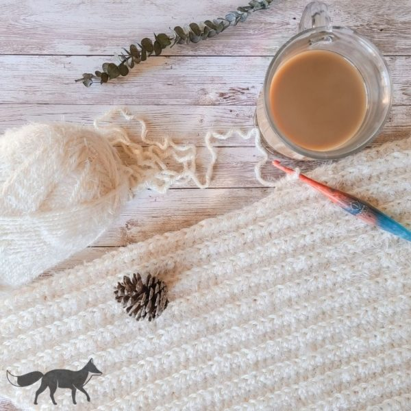 easy half double crochet blanket, shown as work in progress with cup of coffee.