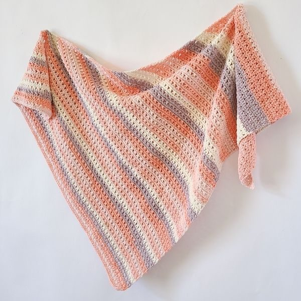 Easy Crochet Triangle Shawl shown hanging to see ease.