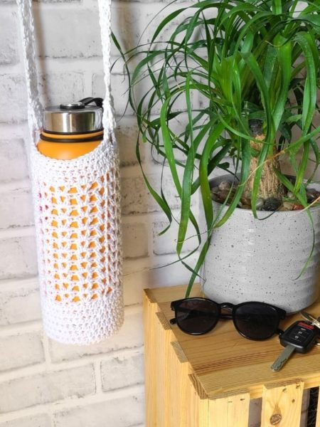 Crochet water bottle bag shown on a large water bottle of 32 oz.