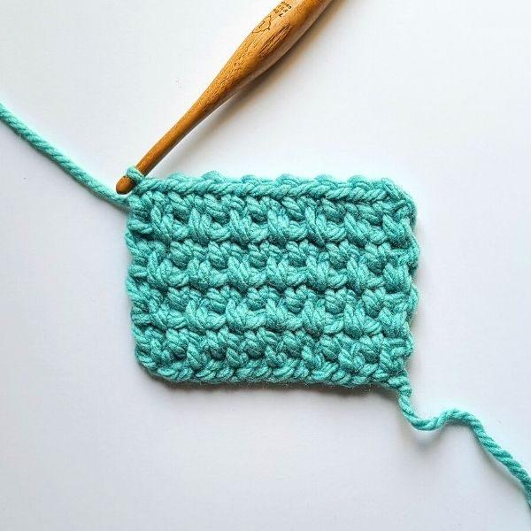 Crochet Moss Stitch in 8 rows, 15 stitches.