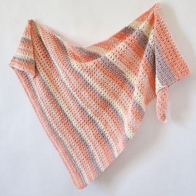 Crochet shawl using crossed double crochet stitch.