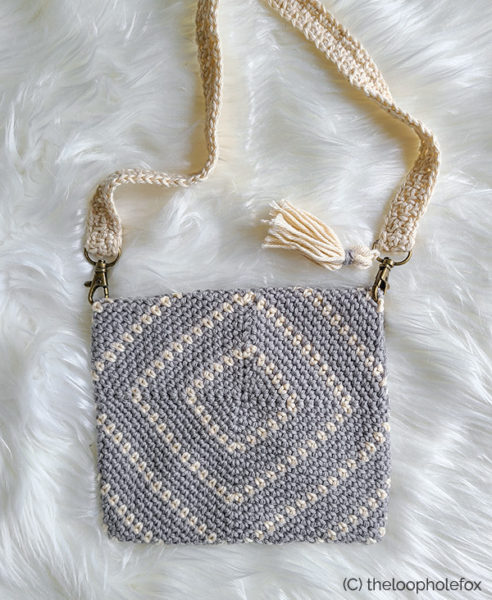 Image shows the back of the bag, so the diamond lines can be seen.
